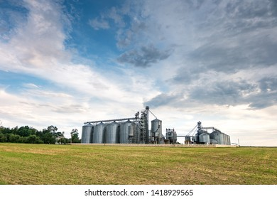 agro-processing plant for processing and silos for drying cleaning and storage of agricultural products, flour, cereals and grain with beautiful clouds