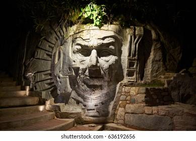 Agua Calientes, Peru - January 4, 2017: Illuminated inca face statue in Agua Calientes city Peru