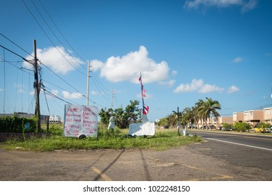 Aguadilla, Puerto Rico / United States - October 19 2017: Signs pleading for help dot the roads throughout the island of Puerto Rico.