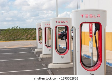 AGUADULCE, SEVILLE, SPAIN - APRIL 29, 2018: A Tesla electric supercharger stand at a gas station in Aguadulce, Seville, Spain