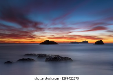 Aguas Blancas sunrise at golden hour with Tagomago island in background , Ibiza , Baleares .