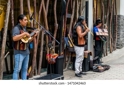 Aguas Calientes, Peru - 05/21/2019: Street musicians playing Eric Clapton in Aguas Calientes in Peru outside of Machu Picchu.