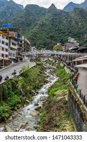 Aguas Calientes, Peru - 05/21/2019: Urubamba River in Aguas Calientes before boarding the bus up to Machu Picchu, Peru.