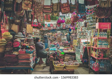 Aguas Calientes, Peru - August 14th, 2018: A grocery store sells artefacts and souvenirs on the street of Aguas Calientes City, at the bottom of Machu Picchu Mountain.