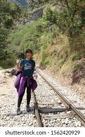 Aguas Calientes, Peru »; August 2017: A girl doing the trekking to Aguas Calientes