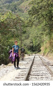 Aguas Calientes, Peru »; August 2017: A smiling girl doing the trekking to Aguas Calientes