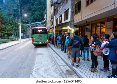 Aguas Calientes, Peru - Sep 14, 2018: Passengers lining up at a terminal in Aguas Calientes for bus going up to Machu Picchu