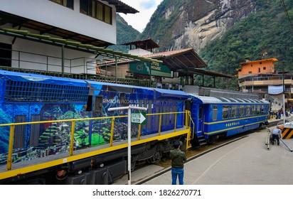 AGUAS  Calientes, PERU - SEPTEMBER 07, 2019 : Train from Cusco  arriving to Aguas Calientes City  at the bottom of Machu Picchu, Peru.