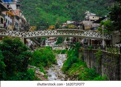 Aguas Calientes town Machu Picchu town white bridge