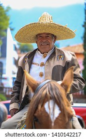 Aguascalientes, México, 04/08/2019. Latino happy old man charro. A charro is a traditional horseman from Mexico, originating in the central-western regions primarily in the state of Jalisco.