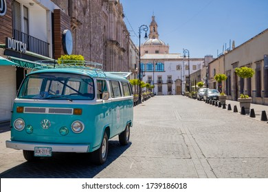 Aguascalientes, Mexico; 05/23/2020; Blue Volkswagen combi in Aguascalientes city center - Venustiano Carranza street - This is how a city center in mexico looks like - well conservated VW combi