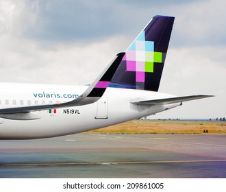 AGUASCALIENTES, MEXICO - NOVEMBER 16, 2013: Symbol mark of Volaris Air on the tail wing photographed at Aguascalientes airport. Volaris is the second largest mexican airline.
