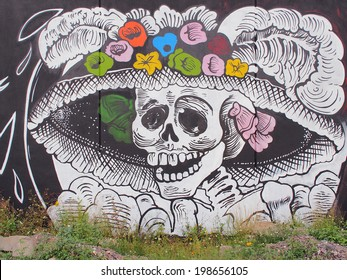 "AGUASCALIENTES, MEXICO - OCTOBER 19, 2013:  Graffiti of ""La Calavera Catrina"", the work of cartoon illustrator Jose Guadalupe Posada. Catrina is icon of Mexican Day of the Dead (Dia de muertos)"