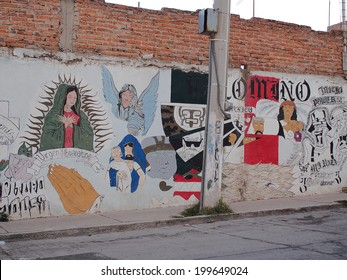 AGUASCALIENTES, MEXICO - OCTOBER 6, 2013:  Religious graffiti or street art in Fraccionamiento Los Pericos area of Aguascalientes city, Aguascalientes State, North central Mexico.