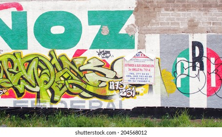 AGUASCALIENTES, MEXICO - SEPTEMBER 20, 2013: Graffiti on top of political propaganda of PRI (Partido Revolucionario Institucional/Institutional Revolution Party) in Fracc Lic. Manuel Comez Morin area.