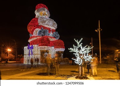 AGUEDA, PORTUGAL - CIRCA DECEMBER 2018: Worlds biggest Santa Claus with 21 meters hight, iluminated by 250. 000 Christmas lights.