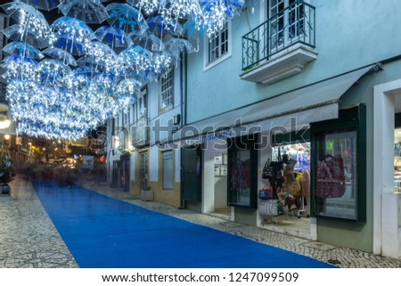 AGUEDA, PORTUGAL - CIRCA DECEMBER 2018: The beauty of white umbrellas iluminated by Christmas lights decorating the streets of Agueda Portugal