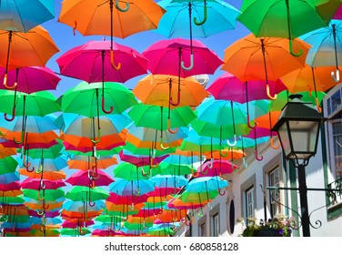 AGUEDA, PORTUGAL - JULY 4, 2017: Umbrella Festival is held every summer in Agueda city and hundreds of umbrellas are hung above the streets.