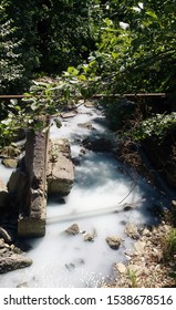 Agurian hydrogen sulfide springs not far from the waterfall