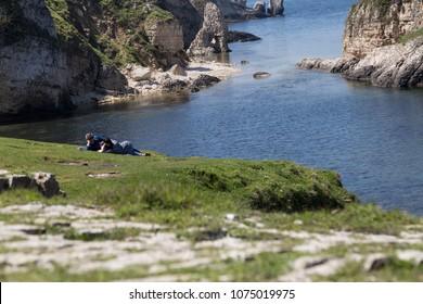 Agva , Turkey - April 19, 2018 ;Rocks in the sea , beautiful landscape in Agva , family at the seaside