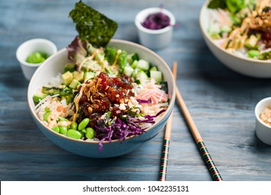 Ahi tuna poke bowl meal horizontal view. Poke is a traditional Hawaiian dish influenced by japanese and asian cuisine. Ahi poke is made of raw tuna chunks tossed over rice & topped with vegetables.