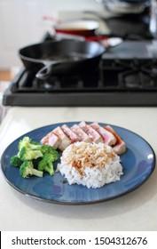 Ahi tuna sliced thin with teriyaki demi-glace, served with rice and broccoli.