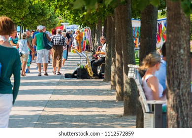 Ahlbeck, Baltic Sea, Germany - August 17, 2015: Seaside Promenade - a boulevard with musicians