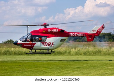 AHLEN GERMANY - JUN 5 2016: DRF Luftrettung (German Air Rescue) BK-117 helicopter landing at Ahlen-Nord heliport