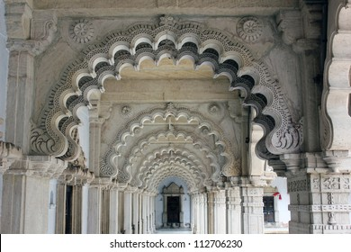 AHMEDABAD, GUJARAT / INDIA - AUGUST 20 : Hutheesing Jain Temple on August 20, 2012 in Ahmedabad. Beautiful stone carved archs on the cloIster.