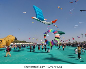 Ahmedabad, Gujarat / India - January 06 2019: A view of the colorful kites soaring up in the sky at the International Kite Festival in Ahmedabad
