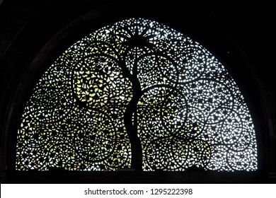 Ahmedabad, Gujarat / India - January 5 2019: The intricate tree of life design at the Siddi Sayed Mosque in Ahmedabad.