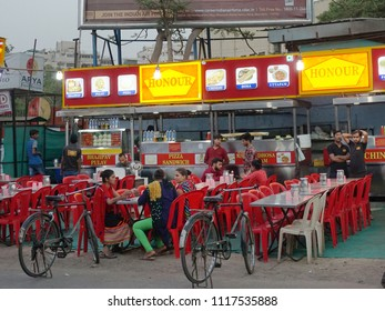 AHMEDABAD, GUJARAT, INDIA, JUNE 07, 2018: Manek Chowk Khau Gali Ahmedabad, a street of popular outdoor eateries that serve all kinds of Indian food at night at affordable rates.