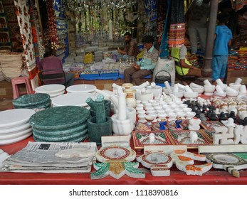 AHMEDABAD, GUJARAT, INDIA, JUNE 07, 2018: Utility items made of white and green marble on display in the evening market.