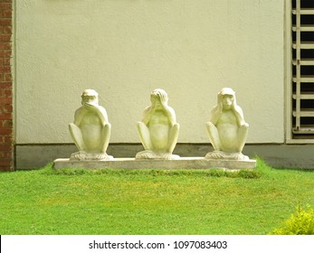 AHMEDABAD, GUJARAT, INDIA, MAY 14, 2018: Sabarmati Ashram where Mahatma Gandhi spent his time during Independence movement. Statues of three wise monkeys - see no evil, hear no evil, speak no evil.