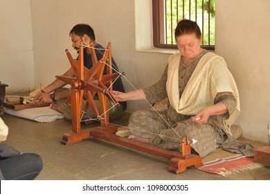 AHMEDABAD, GUJARAT, INDIA, MAY 14, 2018: Demonstration of Charkha (spinning wheel) at the Sabarmati Ashram. Charkha was both a tool and a symbol of the Indian independence movement.