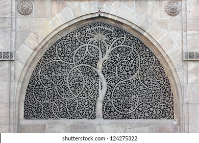 AHMEDABAD, GUJARAT/ INDIA-JANUARY 10 : Sidi Saiyyad Mosque on January 10, 2013 in Ahmedabad. Amazingly hand carved window grille created in 1572 A.D. Jali is wold famous for intricate stone carving.