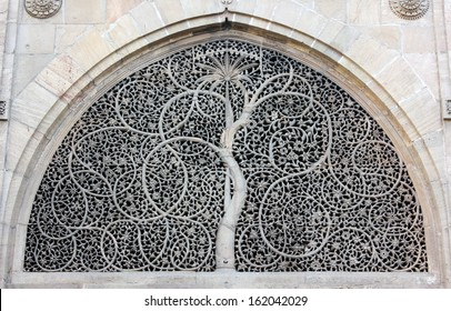 AHMEDABAD, GUJARAT/ INDIA-JANUARY 10 : Sidi Saiyyad Mosque on January 10, 2013 in Ahmedabad. World famous window grille known for its intricate stone carving. Created in 1572 A.D.
