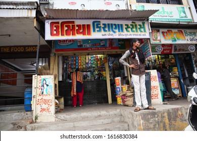 AHMEDABAD, GUJARAT/INDIA - JANUARY 13, 2020:  NARODA VILLAGE UMIYA KIRANA PROVISION STORE A man selling wide variety of food items in his grocery shop.