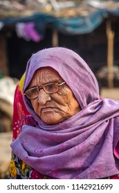 AHMEDABAD, INDIA - DECEMBER 10, 2017: Close up of helpless old aged Indian muslim lady from potter family near village of Makarba, India.