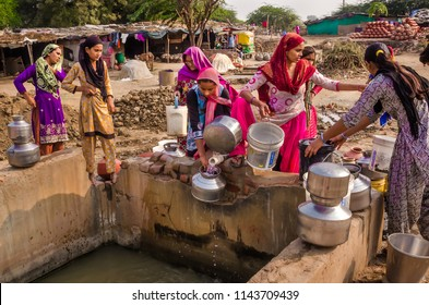 AHMEDABAD, INDIA - DECEMBER 10, 2017: Unidentified muslim potter women from village Makarba gathering water from a water supply nearby well to collect drinking water.