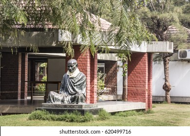 AHMEDABAD, INDIA - FEBRUARY 16, 2017: Statue of Mahatma Gandhi at his Ashram at Ahmedabad, India