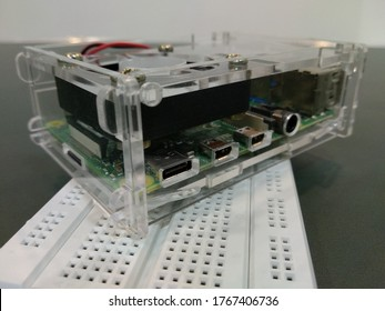 Ahmedabad, India - July 1st 2020: Raspberry Pi 4 with transparent case and fan on breadboard