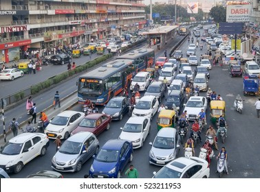 Ahmedabad, India - November 26, 2016: Light volume traffic scene in Ahmedabad. Auto rickshaws and Bus Rapid Transport (BRT) buses provide public transportation.