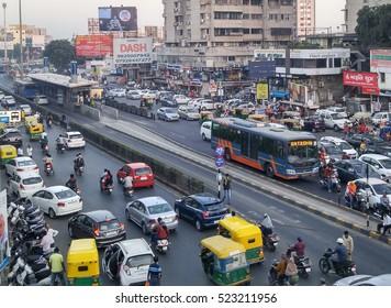 Ahmedabad, India - November 26, 2016: Light volume traffic scene in Ahmedabad. Auto rickshaws and Bus Rapid Transport (BRT) buses provide public transportation.