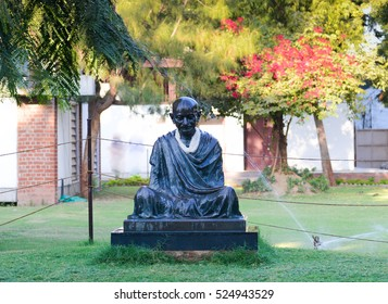 Ahmedabad, India - November 26, 2016: A Statue of Mahatma Gandhi on display at Gandhi Ashram. Gandhi Asharam, also called Sabarmati Ashram was one of the residence of Mahatma Gandhi