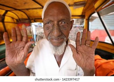 AHMEDABAD, INDIA - NOVEMBER 28, 2018: Unidentified muslim rickshaw driver in Ahmedabad, Gujarat