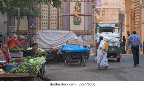AHMEDABAD, INDIA - OCTOBER 29, 2016: Fruit and vegetable sellers outside the Shri Swaminarayan temple gateway in the Kalupur district of the old city