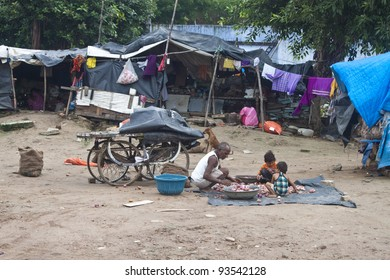AHMEDABAD, INDIA - SEPTEMBER 7: Unidentified poor people living in slum at September 7, 2011 in Ahmedabad, India. About 40 % of Ahmedabad inhabitants live in slums.