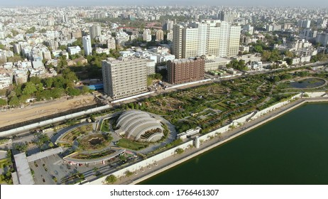 Ahmedabad,Gujarat/India- June 15,2020: Aerial view of riverfront, garde and buildings landscape. Post coronavirus covid-19 city reopens. Social distancing rules after city restrictions ease. Drone fly