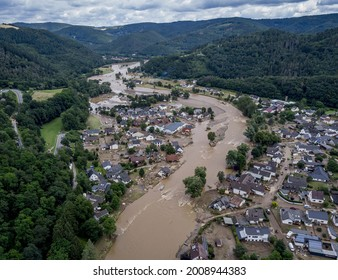 The Ahr river flows past houses destroyed by floods in Insul, Germany, July 15, 2021.
